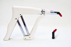 Arma de relleno y Capule de la resina compuesta imagen de archivo libre de regalías