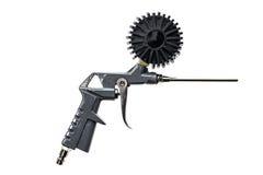 Arma del compresor de aire con el manómetro aislado en un fondo blanco Fotografía de archivo