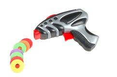 arma del juguete con los puntos negros Imagen de archivo libre de regalías