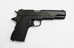 Arma del potro 45 aislado en blanco Imágenes de archivo libres de regalías