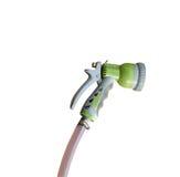 Arma e mangueira de pulverizador velha da água isoladas no fundo branco Foto de Stock