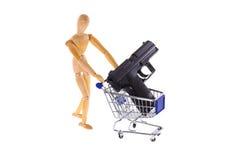 Arma em um carrinho de compras Fotografia de Stock