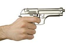Arma en la mano Imagen de archivo libre de regalías