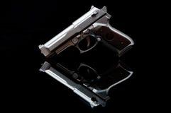 Arma en un espejo Foto de archivo libre de regalías