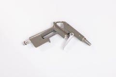 Arma neumático de la herramienta de la trabajo de metalistería en el fondo blanco aislante Foto de archivo libre de regalías