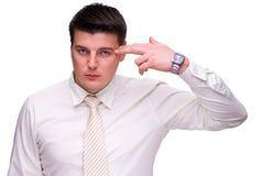 Arma nova do homem de negócio guardarada a sua cabeça Foto de Stock