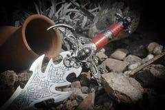 Arma orlata sui precedenti delle rocce Fotografia Stock Libera da Diritti