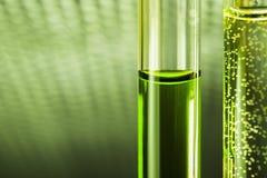 Arma química líquida verde nos tubos de vidro Imagem de Stock Royalty Free