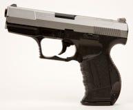Arma semi automático de la mano Imagenes de archivo