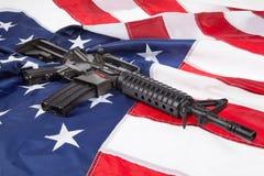 Arma y bandera Fotos de archivo libres de regalías