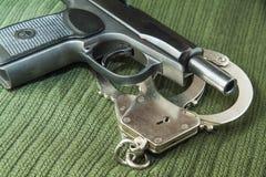 Arma y manillas Fotografía de archivo
