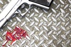 Arma y sangre fotografía de archivo