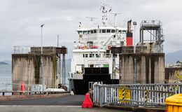 Car ferry about to unload in Armadale, Scotland. ARMADALE, SKYE, SCOTLAND - SEPTEMBER 23, 2014: car ferry about to unload its vehicle and passenger load through Royalty Free Stock Images