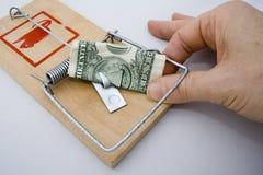 Armadilha do dinheiro - dólar americano & mão Imagens de Stock Royalty Free