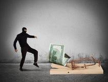 Armadilha do dinheiro do ladrão imagem de stock