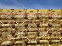 Armadilhas amarelas da lagosta contra o céu Imagens de Stock Royalty Free