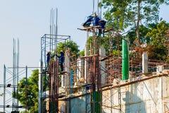 Armadura asiática da malha das mulheres na construção civil Fotos de Stock Royalty Free