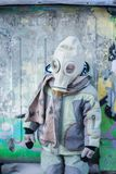 Armageddon. a small child in. A gas mask from a chemical attack. chemical protection mask stock images