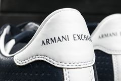 Armani Exchange logo on the modern leather sport shoes. Armani Exchange is the brand of the Fashion creator Giorgio Armani. Sankt-Petersburg, Russia, February 6 royalty free stock photos