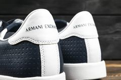 Armani Exchange logo on the modern leather sport shoes. Armani Exchange is the brand of the Fashion creator Giorgio Armani. Sankt-Petersburg, Russia, February 6 stock image
