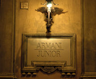 Armani-Jüngerzeichen Stockfotografie