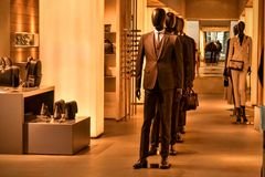 Armani suits dresses bags Stock Photography