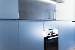 Armarios de cocina azules Foto de archivo libre de regalías