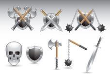 Armas brillantes de plata y un cráneo Fotos de archivo libres de regalías