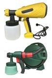 Armas de espray industriales amarillos y verdes para pintar aislado en el fondo blanco Foto de archivo libre de regalías