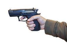 Armas a disposición del hombre aislado en el fondo blanco foto de archivo