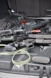 Armas en el coche Fotos de archivo
