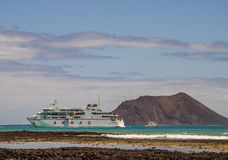 Armas ferry. Large Armas ferry carrying cars and passengers arriving sailing between the port of Playa Blanca in Lanzarote and Corralejo in Fuerteventura, Canary Royalty Free Stock Photos