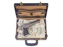 Armas y dinero Imágenes de archivo libres de regalías