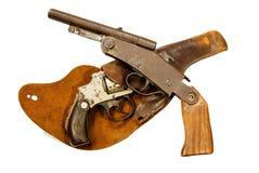 Armas y pistolera antiguos Fotos de archivo