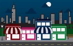 Armazene partes dianteiras e edifícios da skyline na noite Fotos de Stock Royalty Free