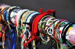 Armband som hänger på ett staket Royaltyfria Bilder