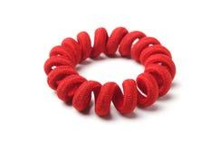 Armband van rood rubber stock foto's