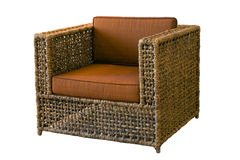 Armchair. Comfortable rattan armchair on white background royalty free stock photos