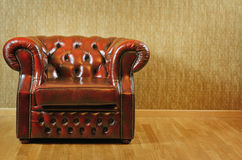 Armchair. Single Old Antique Armchair Near The Wall Stock Image