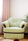 Armchair. In the corner of room near a window Royalty Free Stock Photography