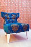 Armchair on ancient wall. Designed armchair on ancient wall Royalty Free Stock Photography