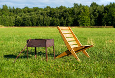 Armchair and barbecue Stock Photography