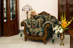 Armchair in baroque. Style with some cushions royalty free stock photo