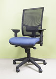 Armchair black and blue. High-end office chair covered with blue coating Stock Photography