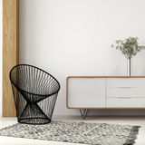 Armchair of black thread in white interior Stock Image