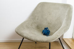 Armchair and blue knitting wool with needles Royalty Free Stock Photo