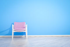 Armchair blue wall Royalty Free Stock Images