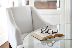Armchair with book and eyeglasses Interior decoration Royalty Free Stock Photography