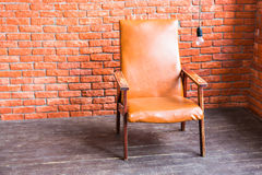 Armchair On Brick Wall Background Stock Photos
