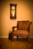 Armchair and Clock Royalty Free Stock Image